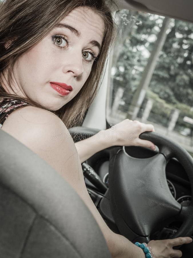 Stressed woman driving car royalty free stock photo