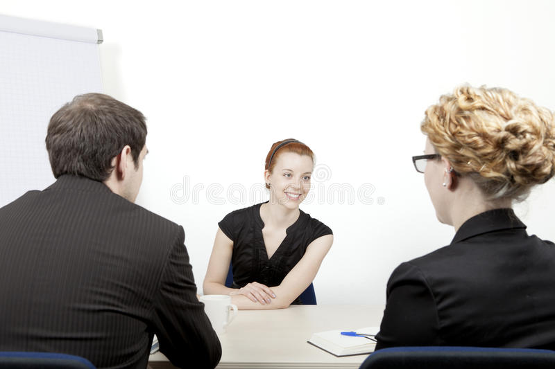 Young woman being interviewed royalty free stock image