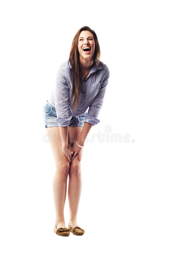 Free Young Woman Bent Over Laughing Royalty Free Stock Photography - 26393637