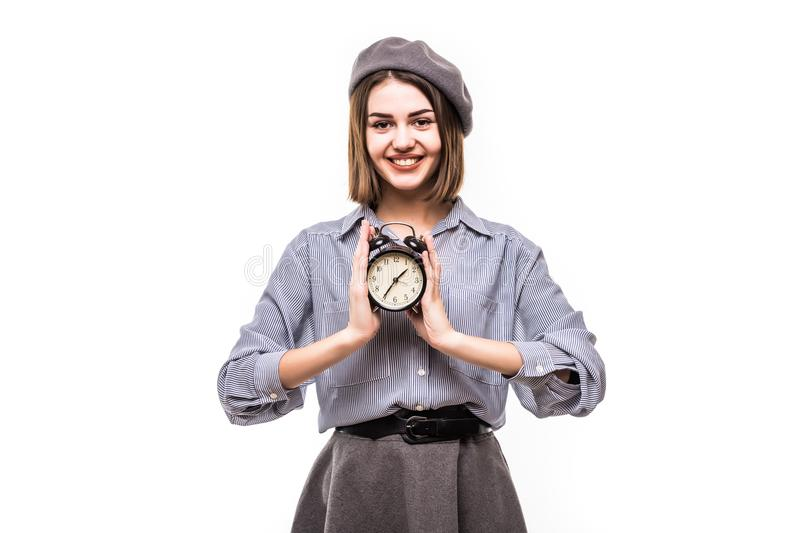 Young woman in beret with clock in hands isolated on white background royalty free stock photos
