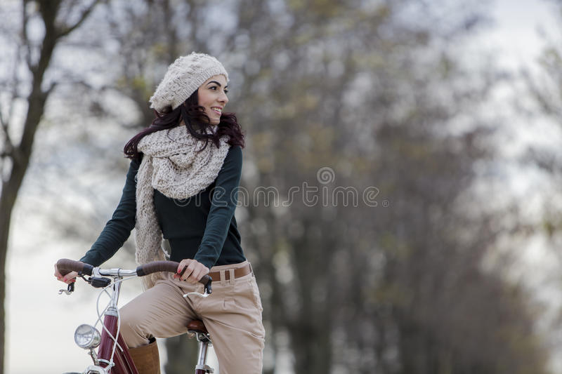Young woman with a bicycle stock photo