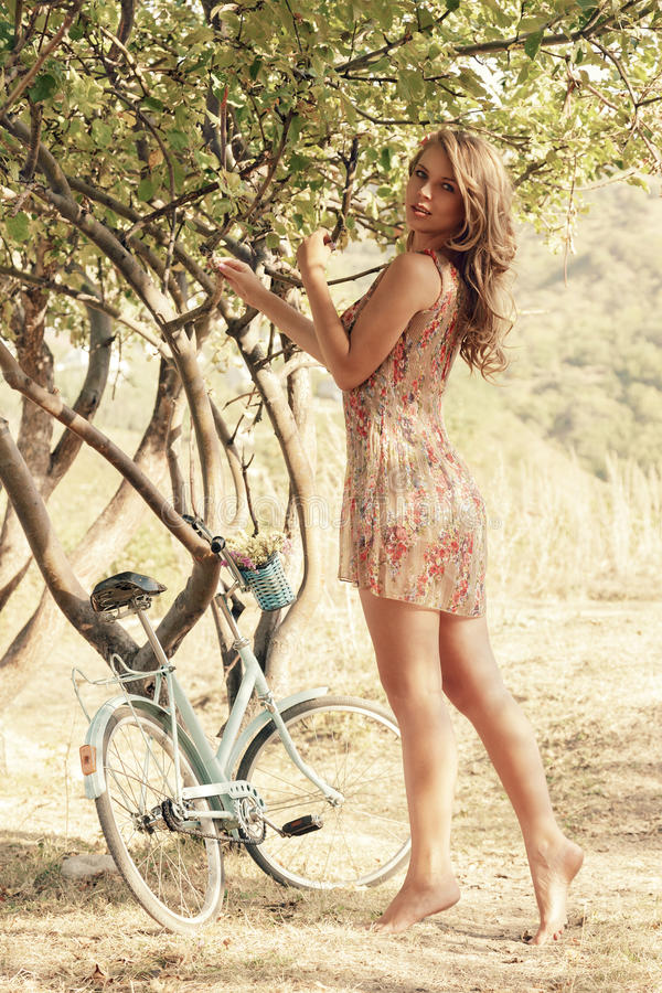Young Woman With Bicycle In A Park Stock Photos