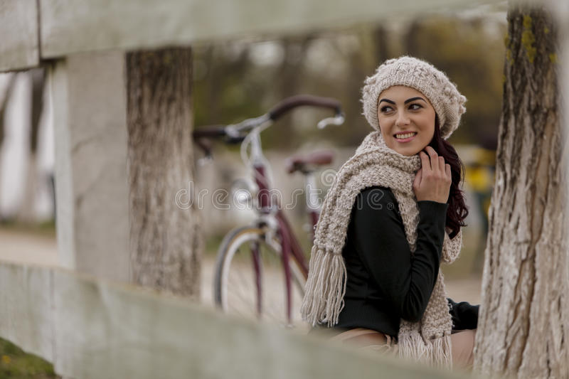 Young woman with a bicycle stock images