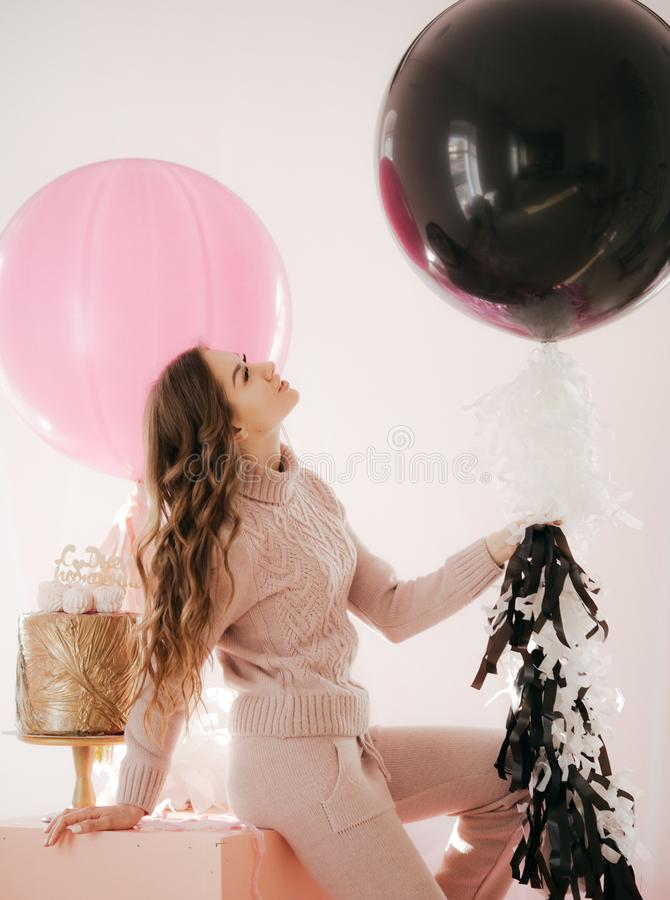Young woman with big balloons stock images