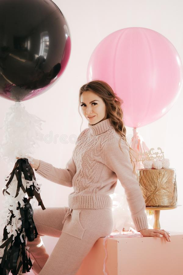 Young woman with big balloons royalty free stock photo