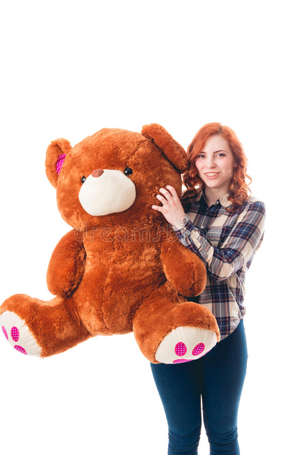 Young woman with big bear, isolated over white background. Attractive young woman with big bear, isolated over white background royalty free stock photos