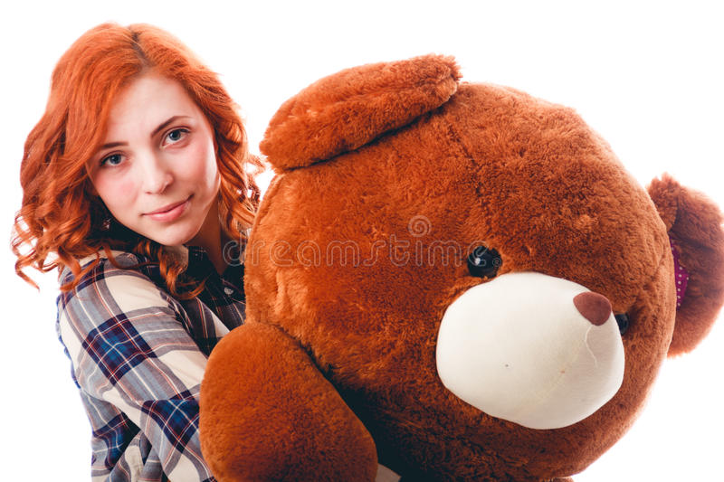 Young woman with big bear, isolated over white background. Attractive young woman with big bear, isolated over white background stock images