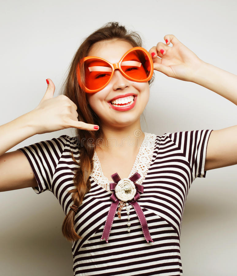 Young woman with big party glasses royalty free stock image
