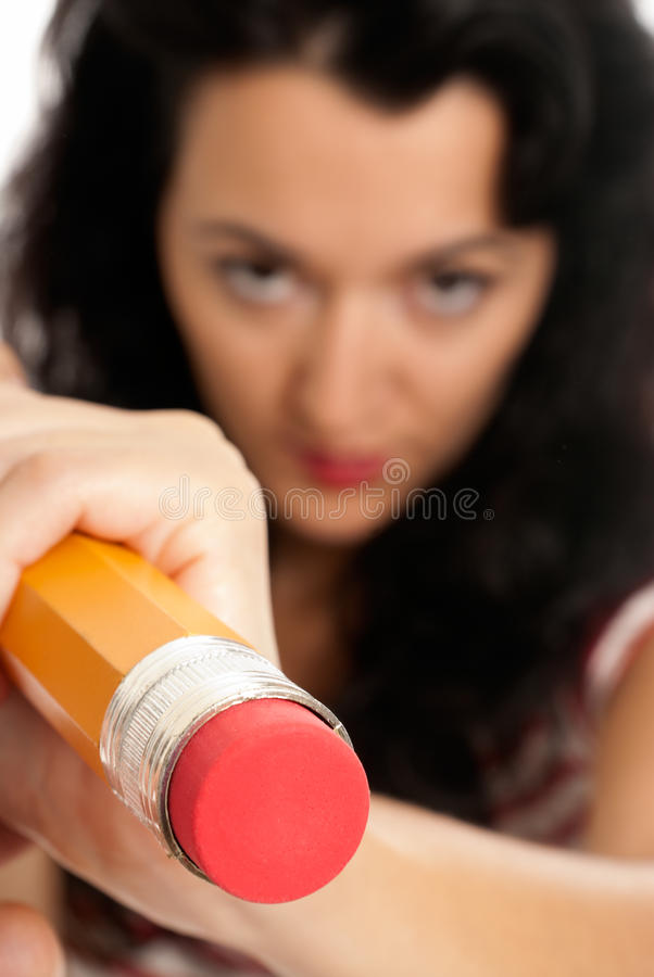 Young woman with big pencil eraser rubber isolated