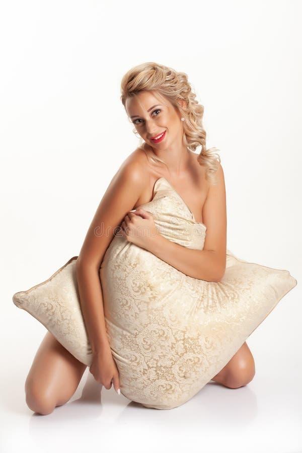 Young Woman With A Big Pillow stock photos
