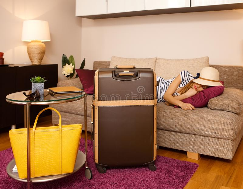 Young woman and big suitcase stock images