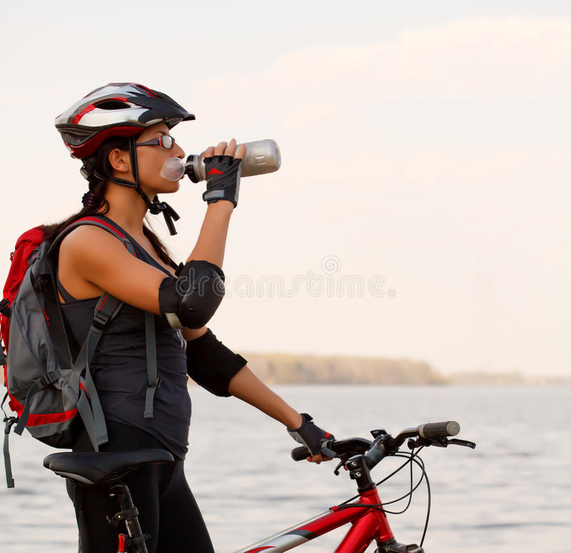 Young woman with a bike stock image