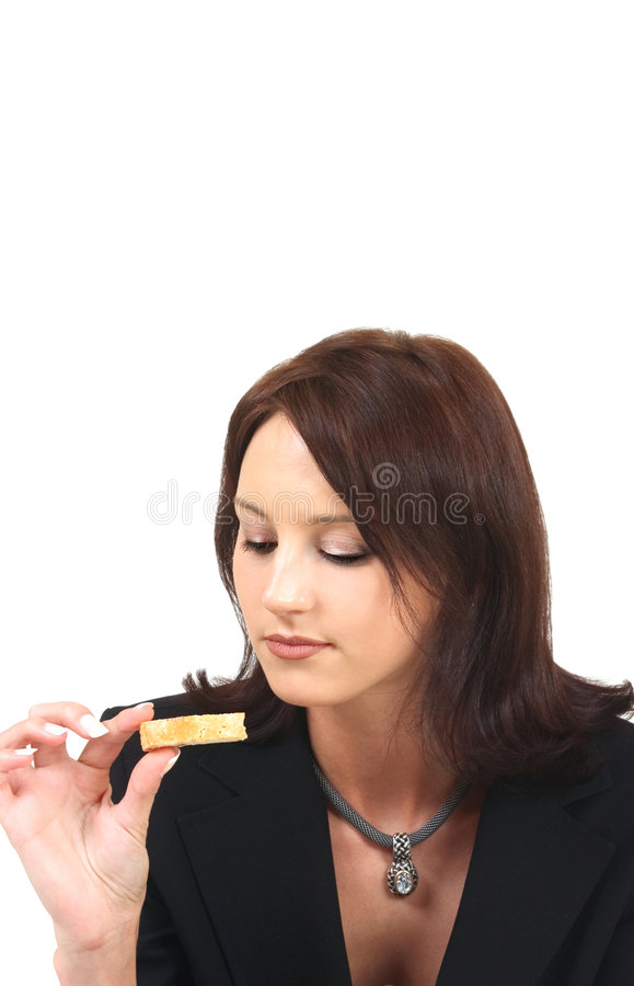 Young woman with a biscuit stock photos