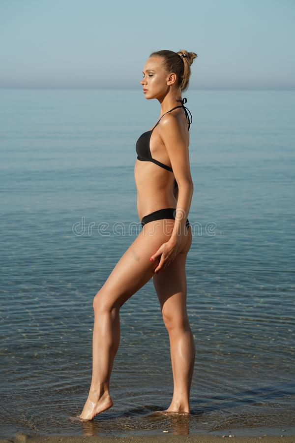 Woman in bikini on the beach royalty free stock image