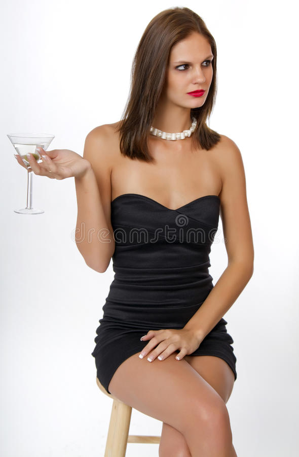 Young Woman in Black Cocktail Dress stock photography