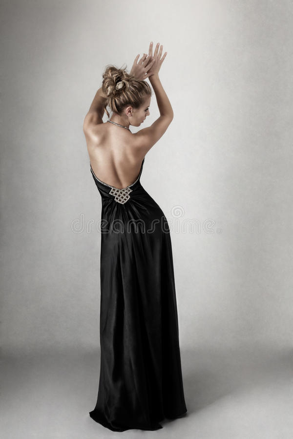 Young woman in black dress royalty free stock photography