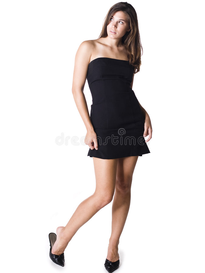 Young woman in black dress. Young woman wearing a black strapless cocktail dress stock photos