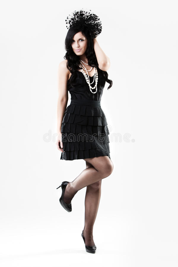 Young Woman In Black Dress And High Heels Stock Photos