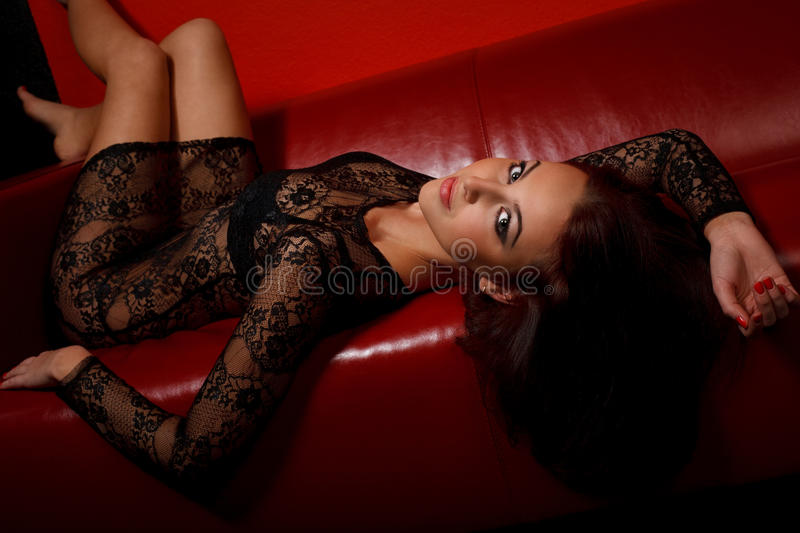 Download Young Woman In Black Dress Lying On Sofa Stock Photo - Image: 16481862
