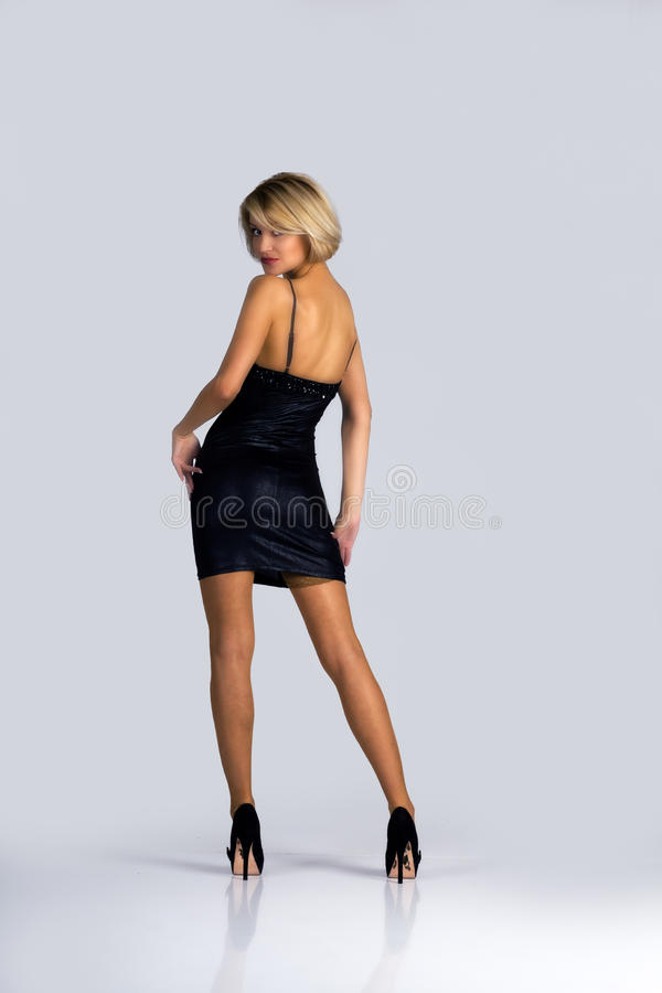 Young woman in a black dress stock image