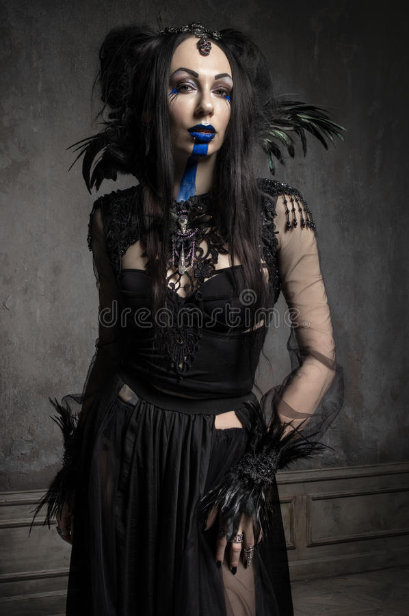 Young woman in black fantasy costume stock photography