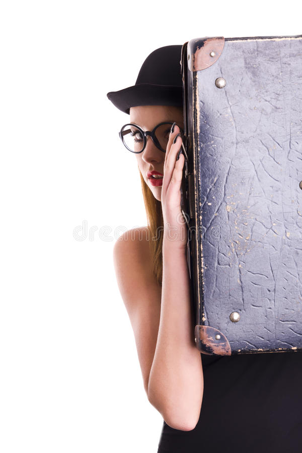 Young woman in black hat and vintage suitcase royalty free stock photo