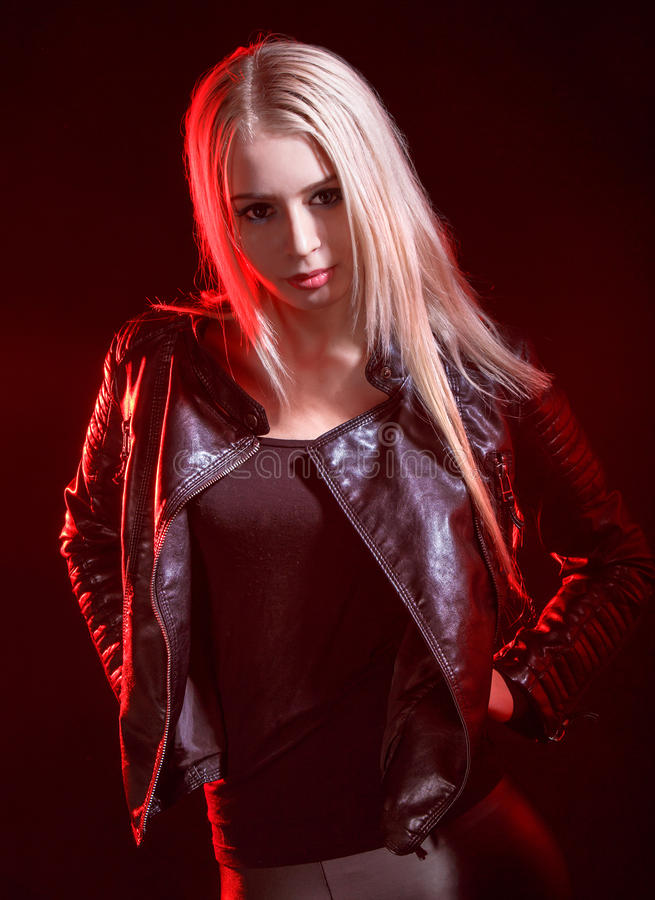 Woman in a black leather jacket royalty free stock photos
