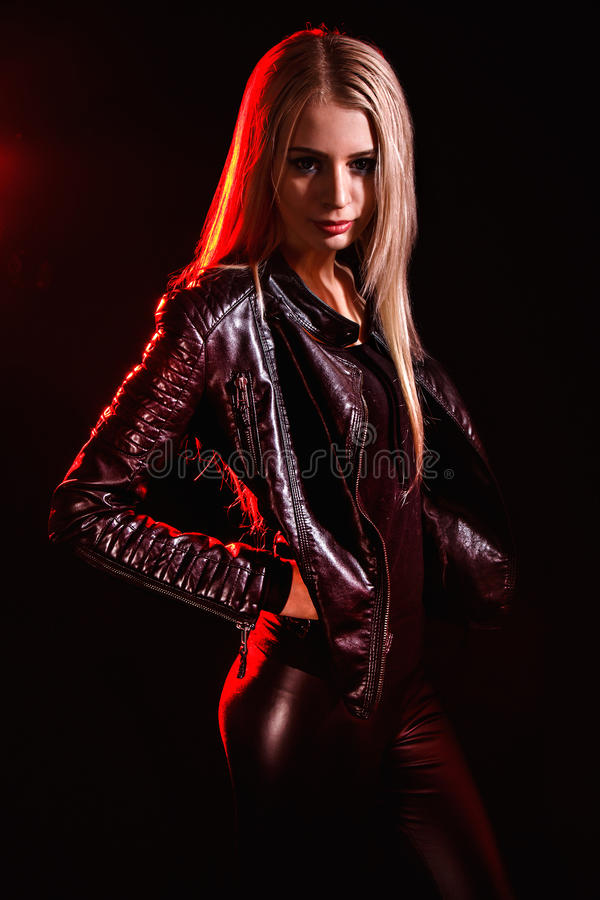 Woman in a black leather jacket stock images