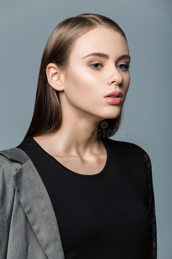 Young woman in black leotard stock image