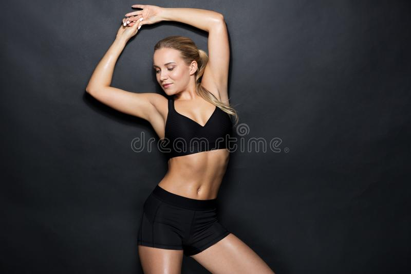 Young woman in black sportswear posing royalty free stock photos