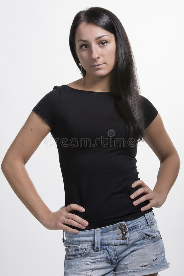Download Lovely Brunette Standing With Arms On Hips Stock Photo - Image of portrait, self: 29919984