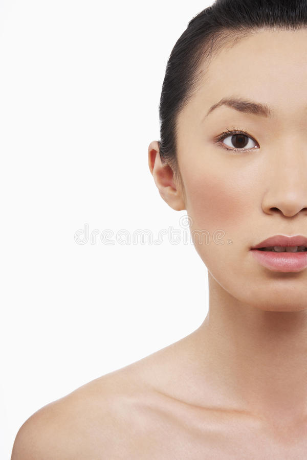 Young Woman With Blank Expression. Closeup of young Asian woman with blank expression on white background stock images