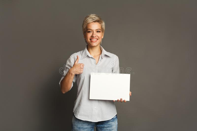 Young woman with blank white paper stock image