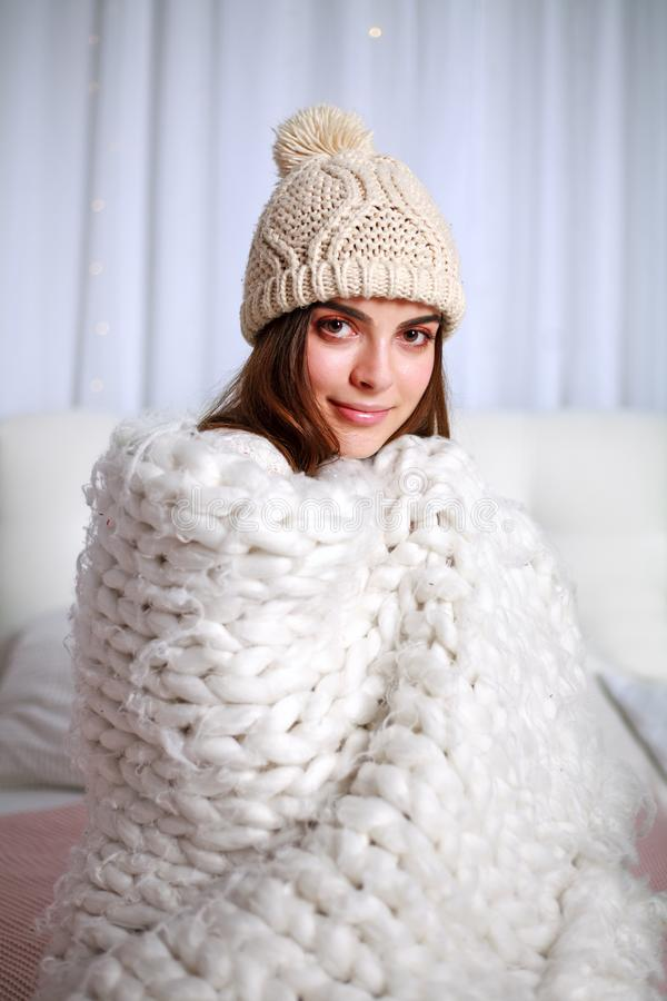 Young woman in blanket get warm at home bedroom royalty free stock photo