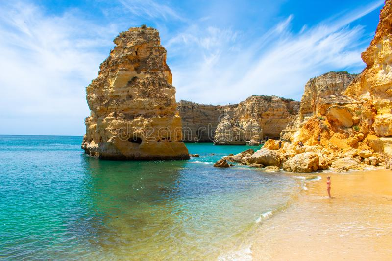 Young woman with blond hair and red bikini standing on beautiful beach Praia de marinha in Algarve, Portugal stock image