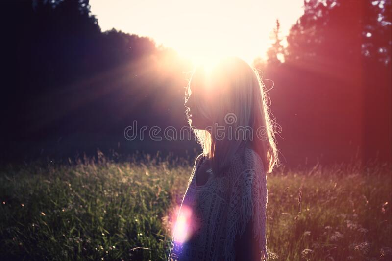 Young woman with blond hair seen in profile stock photos