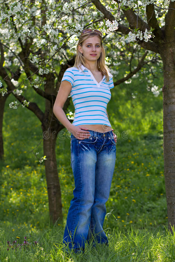 Young Woman in Blooming Park stock photo