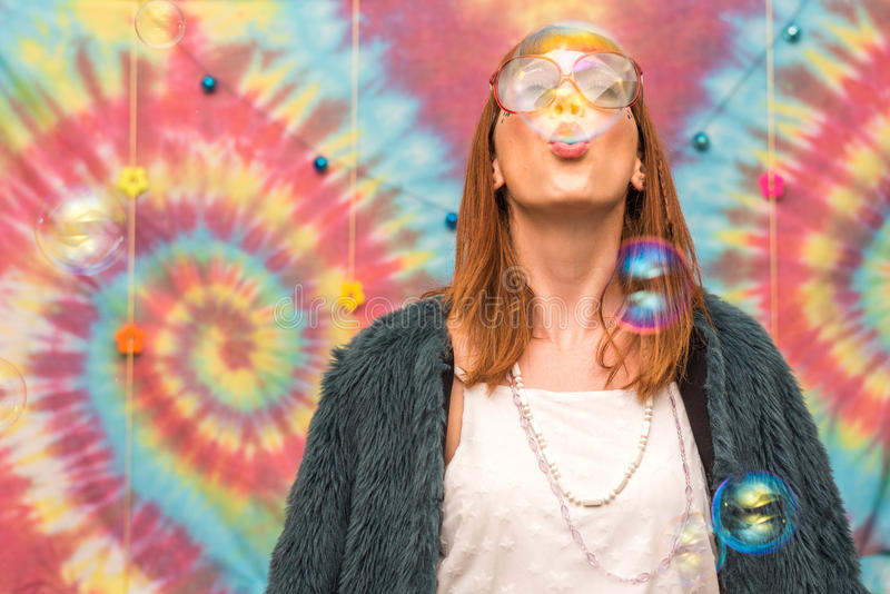 Young woman blowing bubble royalty free stock images