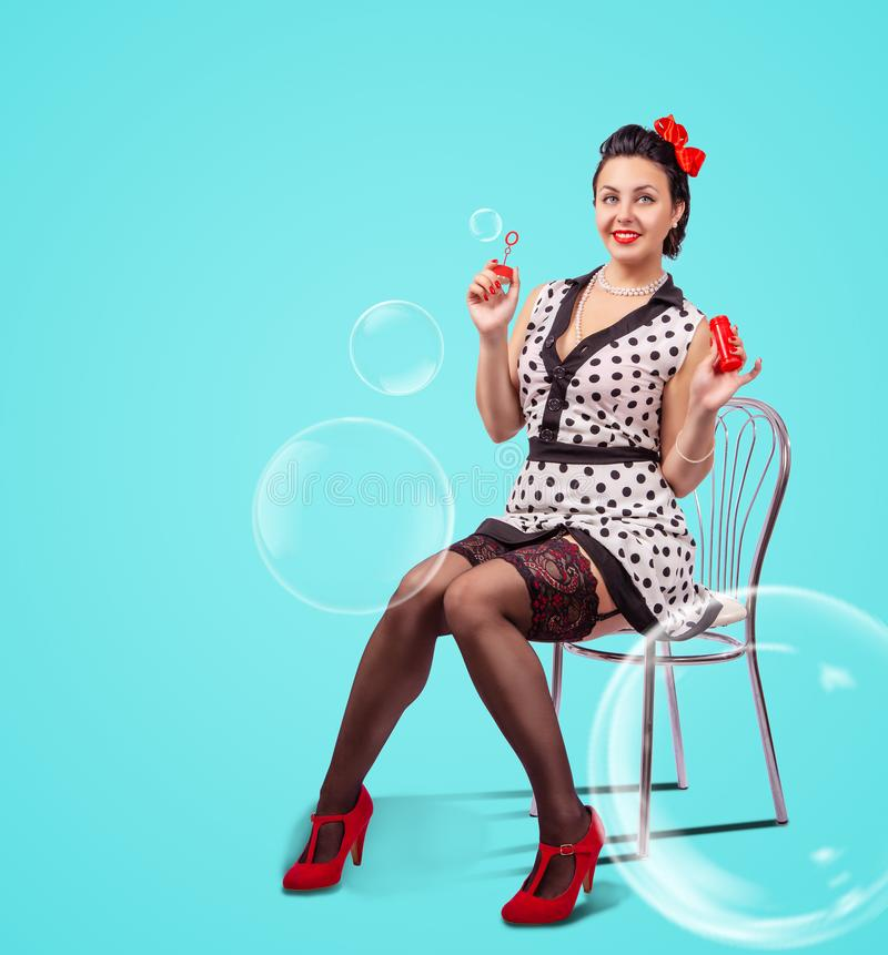 Young woman blowing bubbles indoor stock photos