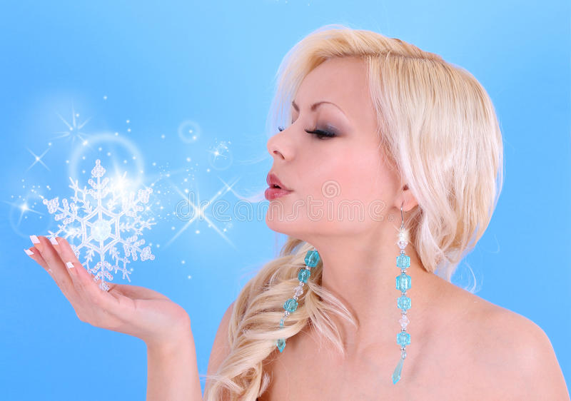 Download Young Woman Blowing Kiss With Snowflakes And Stars On Blue Stock Image - Image: 28268367