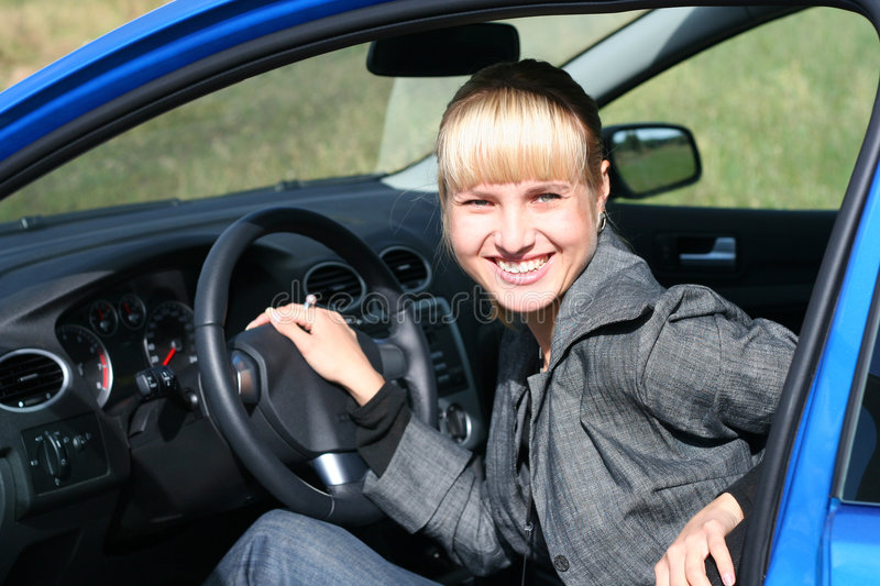 Download Young woman in a blue car stock image. Image of sensuality - 3238749
