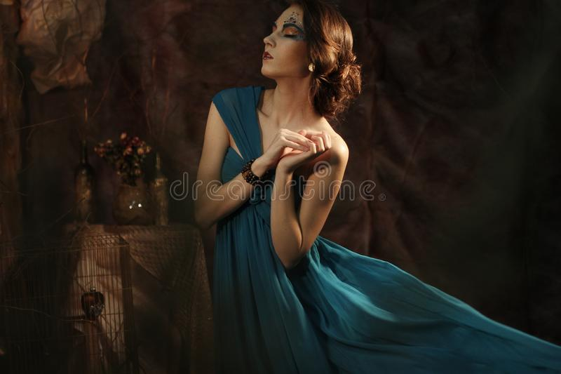 Young woman in blue dress royalty free stock photography