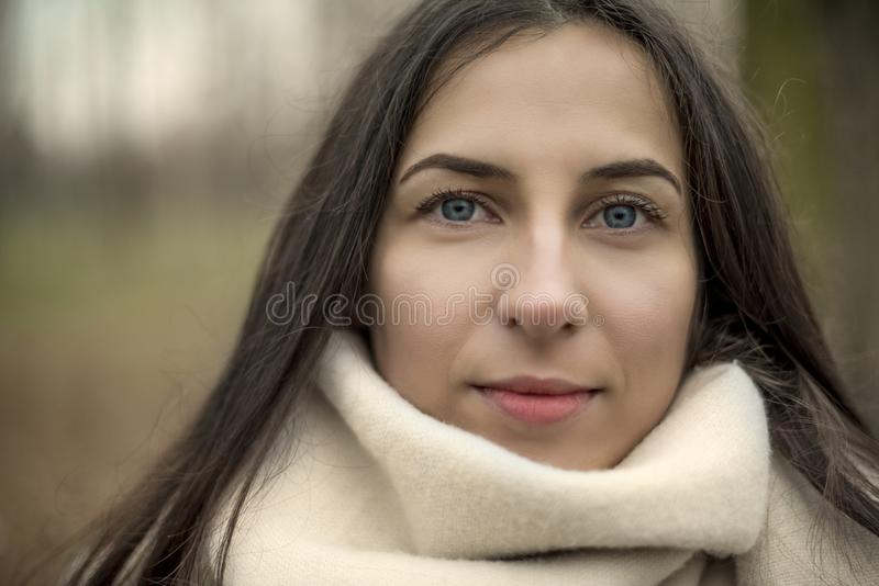 Young woman with blue eyes outdoors portrait looking at the came stock images