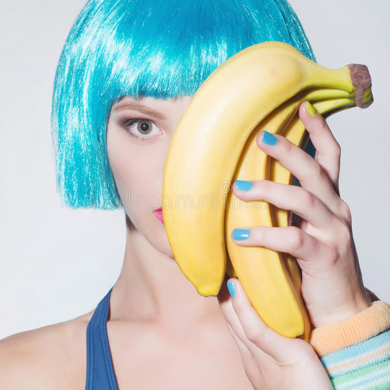 Young woman blue hair bob with bananas. Portrait of girl with bananas.Healthy food concept. young woman blue hair bob stock images
