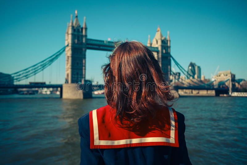 Young woman on boat looking at Tower Bridge stock photos