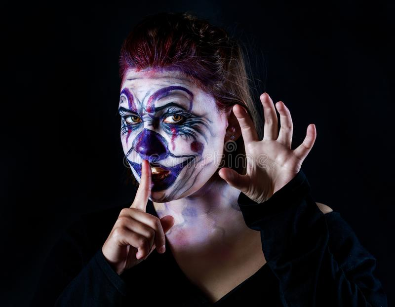 Halloween ugly clown. Young woman with body painting on her face, ugly scary clown, Halloween topic royalty free stock photos