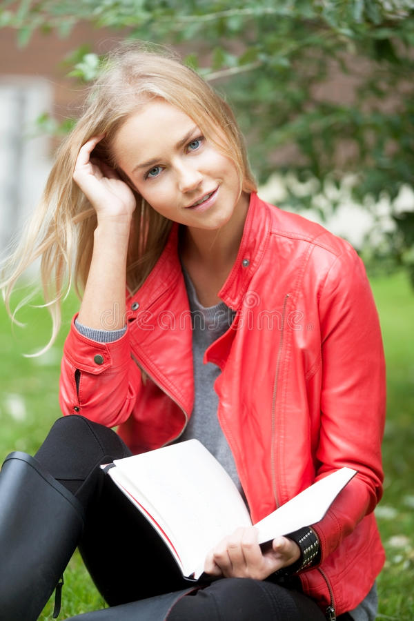 Young woman with book. Portrait of a beautiful young woman with book stock image