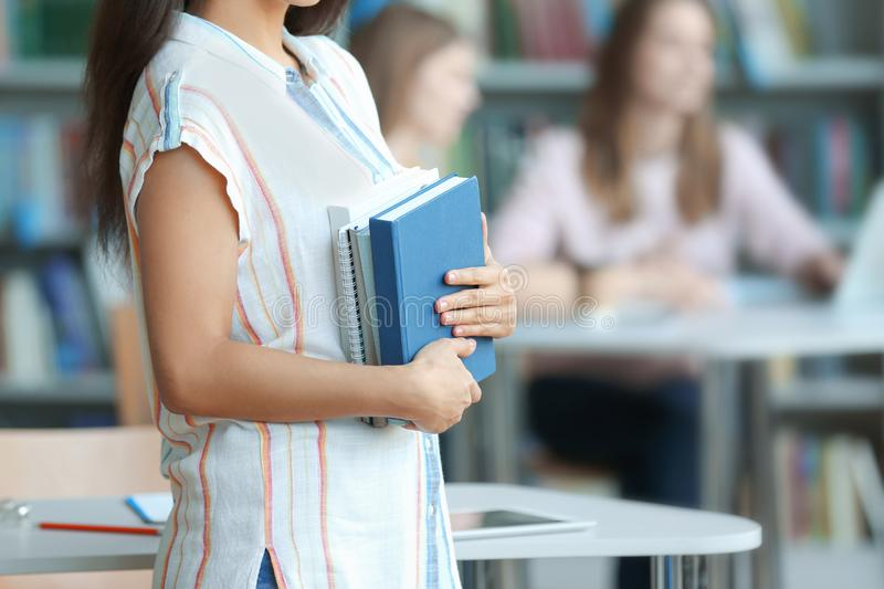 Young woman with books in library, closeup royalty free stock photos