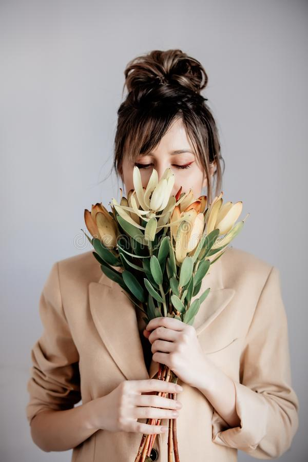 Young woman with bouquet of Leucadendron stock photos