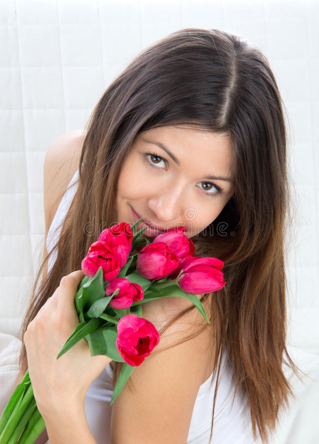 Download Young Woman With Bouquet Of Red Tulips Flowers Stock Photo - Image of plant, happy: 23955936
